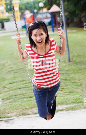 Portrait of a young woman laughing - Stock Photo