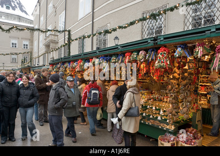 Stalls at the Christmas Market in Domplatz (Cathedral Square), Old Town (Altstadt), Salzburg, Austria - Stock Photo