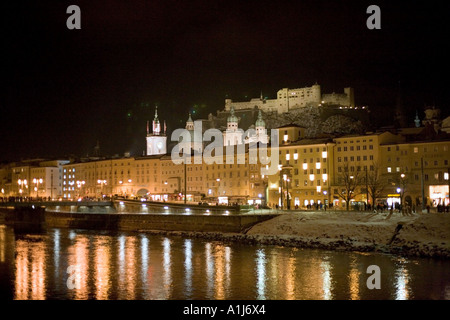 View over the River Salzach towards the old town and Hohensalzburg Fortress at night on New Year's Eve, Salzburg, - Stock Photo