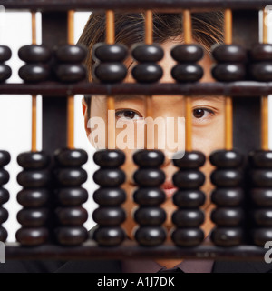 Portrait of a businessman behind an abacus - Stock Photo