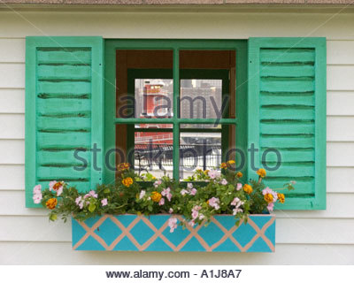 idyllic windows with flower box looking out to our world tugboat on the East River NYC - Stock Photo