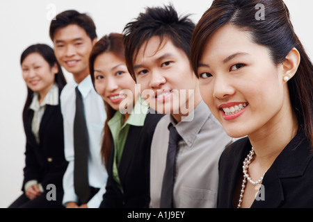 Portrait of three businesswomen with two businessmen smiling - Stock Photo