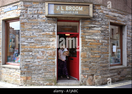 A customer visits a bookshop in Stromness on Mainland Orkney in Scotland UK - Stock Photo