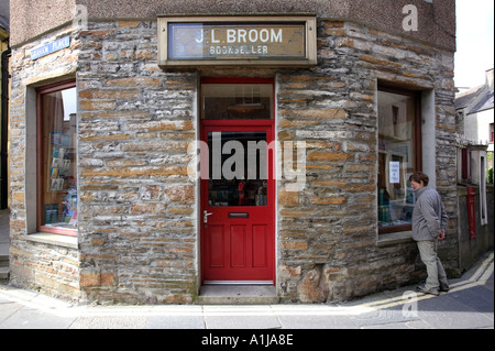 A local window shops at a bookshop in Stromness on Mainland Orkney in Scotland UK - Stock Photo