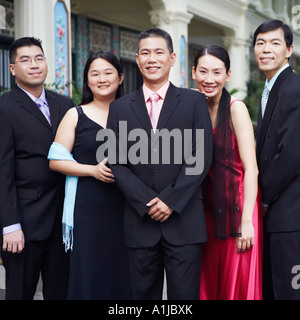 Portrait of four businessmen and two businesswomen standing - Stock Photo