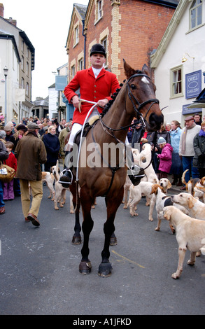 Golden Valley Hunt assemble at the Town Clock Square in Hay on Wye Powys Wales UK GB red coat huntsman - Stock Photo