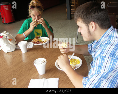 Teens eating Breakfast in Restaurant - Stock Photo