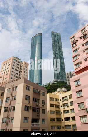Newly built skyscraper with twin towers towering over older apartment blocks in Happy Valley - Stock Photo
