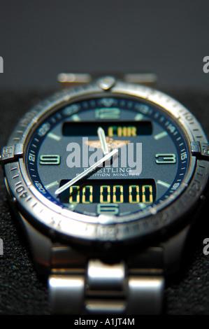 Breitling Aerospace repetition minutes titanium gents wristwatch black background - Stock Photo