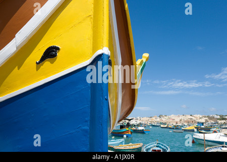 Typical fishing boat or luzzu on the quayside in the harbour at Marsaxlokk, Malta - Stock Photo