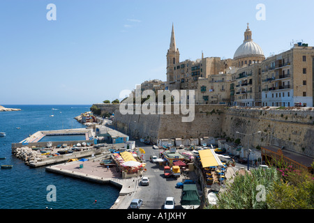 Seafront looking towards the old city with the dome of the Carmelite Church, Valletta, Malta - Stock Photo