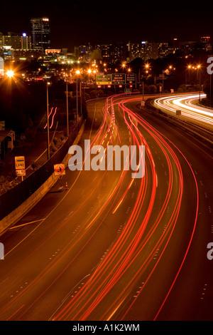 Northern Motorway at night Auckland North Island New Zealand - Stock Photo