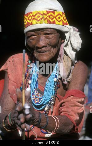 San Bushwoman making jewellery out of ostrich egg shell in village near Tsumkwe in Kalahari Desert East Namibia - Stock Photo