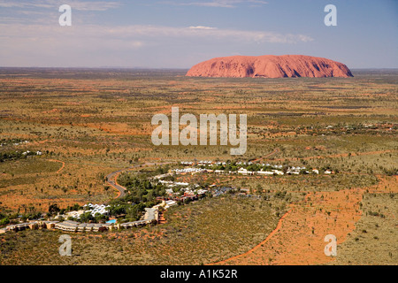 Yulara Village and Uluru Ayers Rock Uluru Kata Tjuta National Park World Heritage Area Northern Territory Australia - Stock Photo