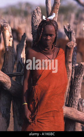 Himba woman and her distinctive hair decoration and adornment village Kaokoveld tribal areas North west of Opuwo - Stock Photo