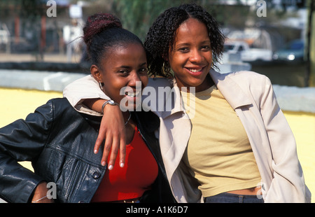 Friendly local girls pose for a photo Maherero Day Celebrations are is held in Okahandja in August each year Namibia - Stock Photo