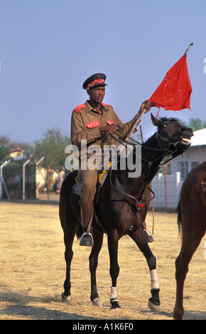 Member of paramilitary style group in uniform and on horseback for Maherero day August Namibia - Stock Photo