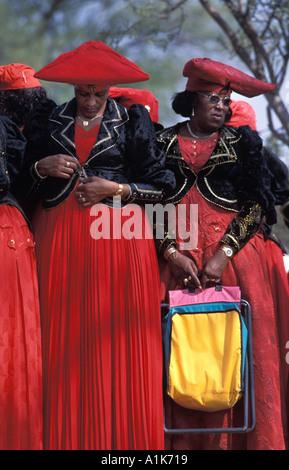 Herero women wearing traditional dress in procession for the Ma Herero Day Parade August Okahandja Namibia - Stock Photo