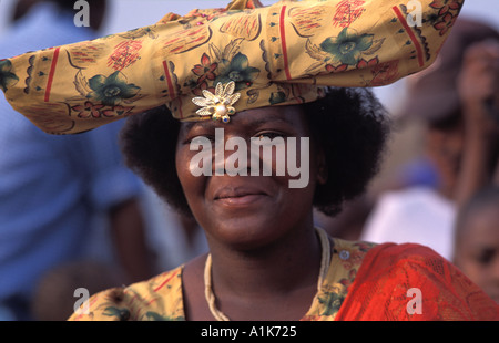 Friendly Herero woman wearing traditional dress in procession for the Ma Herero Day Parade August Okahandja Namibia - Stock Photo