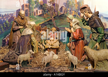 Old church nativity scene with plaster figures from 1920 - Stock Photo