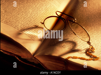 Pince-nez on old book, Stowasser (latin-german) - Stock Photo