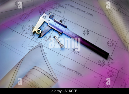Calliper with construction plans and screw - Stock Photo