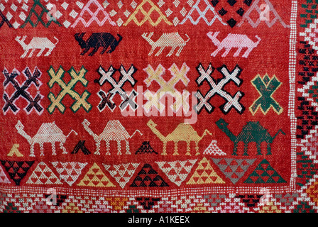 Woven woollen textile with camel motifs from Morocco - Stock Photo