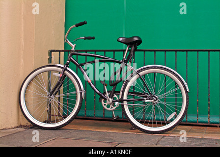 Old type of bicycle leaning against wall - Stock Photo