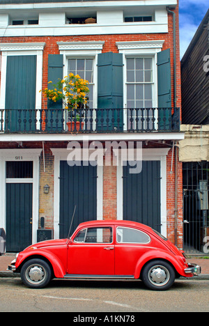 red volkswagen beetle parked in front of consignment shop in the stock photo royalty free image. Black Bedroom Furniture Sets. Home Design Ideas