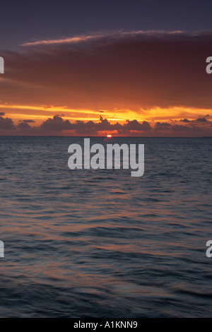 Clouds over the ocean at sunset in the Florida Keys. - Stock Photo