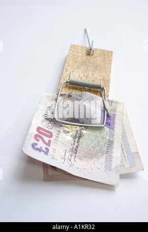 Cash money banknote caught in a mousetrap
