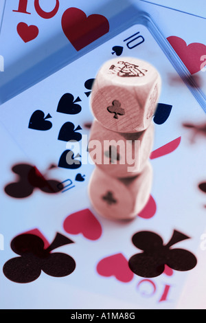 Stack of Dice on Playing Cards - Stock Photo
