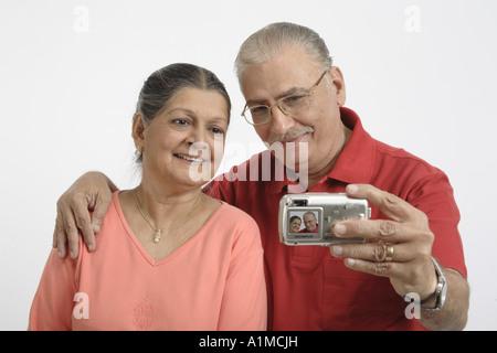 Indian senior citizen couple on white background - Stock Photo