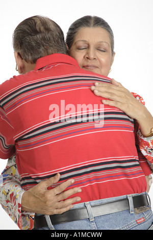 Loving Indian senior citizen couple standing embracing each other - Stock Photo