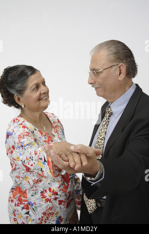 Indian senior citizen couple husband wife hand in hand - Stock Photo