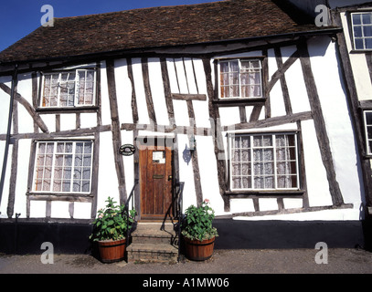 Suffolk East Anglia old half timbered black and white cottage with front door opening directly onto pavement - Stock Photo