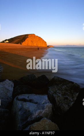 Winter Sunset Over East Cliff At West Bay Dorset UK - Stock Photo