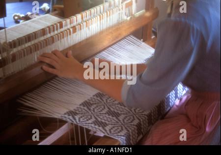 Woman demonstrating weaving at Old Sturbridge Village Massachusetts MS US USA - Stock Photo