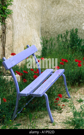A Pretty Blue Bench Seat Found In A Small Village In Provence France - Stock Photo