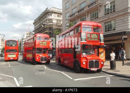 London Oxford Street 2 two routemaster buses on same number 13 thirteen route to Golders Green advertising Harrods - Stock Photo