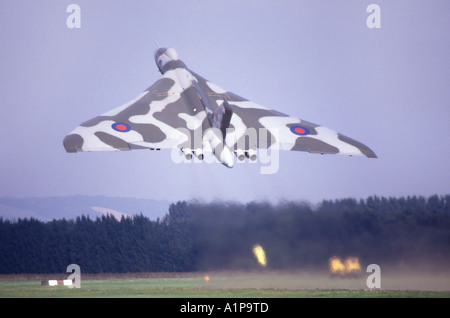 Vulcan bomber taking off from airfield - Stock Photo