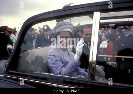 Queens Silver Jubilee UK 1977 Queen Elizabeth waving with Duke of Edinburgh in car she meets well wishers South - Stock Photo