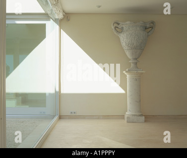 View of an urn against a wall - Stock Photo