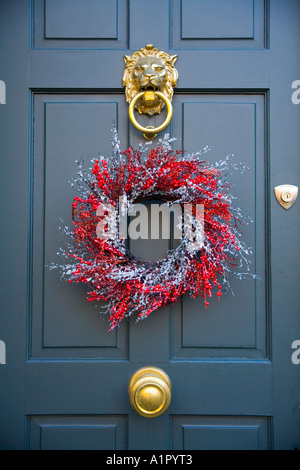 A Christmas Wreath Hanging On A Green Front Door.   Stock Photo