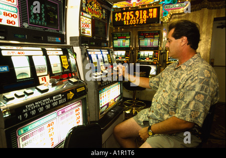 A man plays the slot machines at the Circus  Circus Hotel and Casino in Las Vegas Nevada  USA - Stock Photo