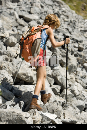 Child hiking across rocks - Stock Photo