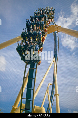 Riders hang suspended and loop up side down from the Montu roller coaster at Busch Garden Tampa Florida USA - Stock Photo