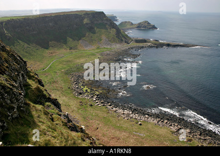 Cliffs and Causeway: The sweep of the bay around to the east of the giant's causeway and the point of land that - Stock Photo