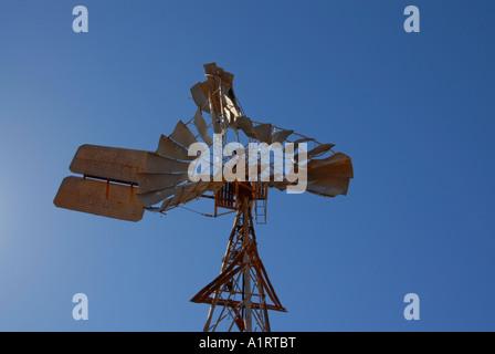 Broken windmill in the Pilbara, on a sheep station, Western Australia - Stock Photo