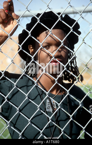 Black TeenGirl Standing Behind Wire Fence St Paul Minnesota - Stock Photo